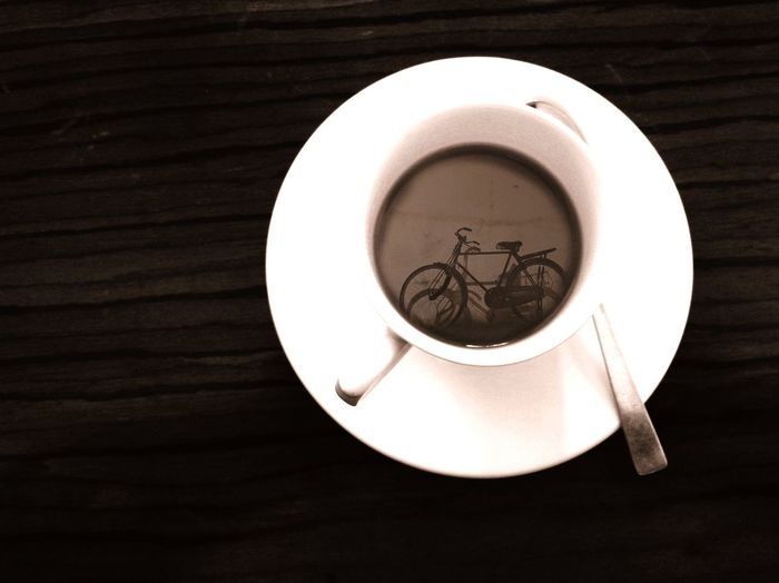A bicycle in a tea cup Close-up Plate No People Drink Table Indoors  Directly Above TeaCup Cycle Reflection Food Stories