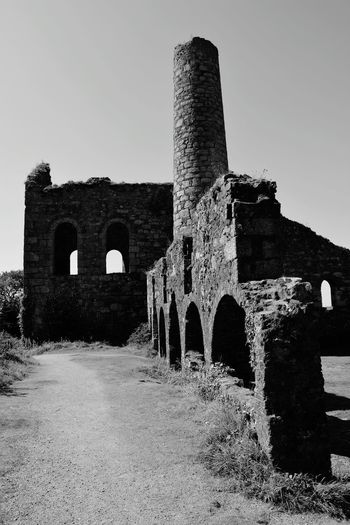 History Old Ruin Day Architecture Outdoors Chimney Stacks Chimney Chimney Tops Arch Cornwall Uk Ancient Rural Scene Cornwall Cornishmine Cornish Tin Mine Blackandwhite Black & White Blackandwhite Photography No People Built Structure Building Exterior The Past Clear Sky Close-up Revolution
