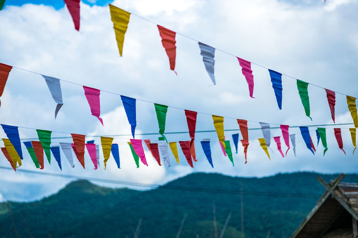 Colorful small flags paper made hanging on the rope with blue sky background, selective focus. Camping Farm Pursuit  Recreation  Bunting Cloud - Sky Countryside Day Flag Hanging Happyiness Low Angle View Multi Colored Nature No People Outdoors Scouts Shelter Sky