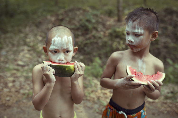 Boys With Painted Face Having Watermelon