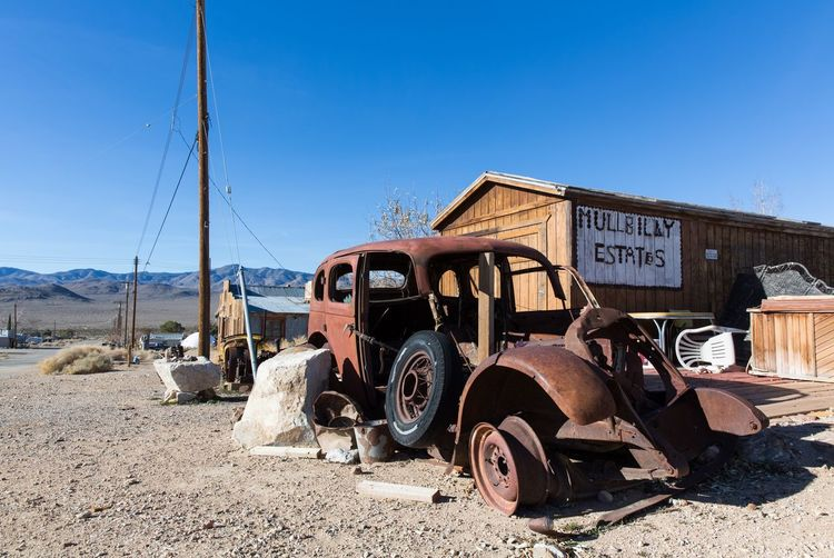Old Ghost Town Transportation Mode Of Transportation Land Vehicle Sky Sunlight Land Nature Day Clear Sky Abandoned Blue Metal No People Obsolete Rusty Old Motor Vehicle Decline Car Damaged