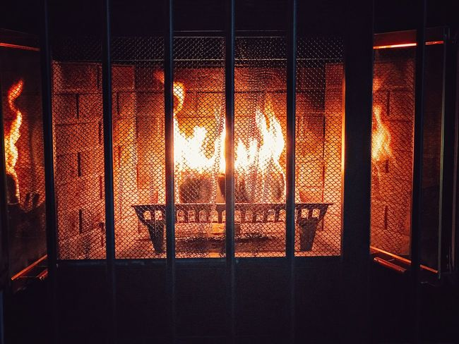 Warm winter fire in the fireplace. Indoors  No People Sunset Backgrounds Night Burning Close-up Sky Fire Fireplace Wintertime Winter Heat Iron Grate ShotOnIphone