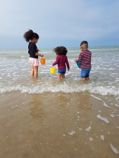 beach life Taking Photos My Kids Child Females Boys Girls Bonding Ankle Deep In Water Sand Pail And Shovel