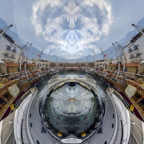 Digital composite image of swimming pool in city against sky