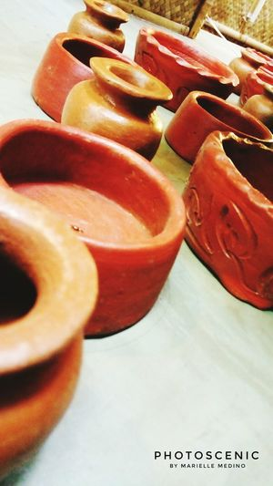 Those clay jars on the wall. Close-up Variation In A Row Red Choice Abundance Group Of Objects Focus On Foreground No People Large Group Of Objects Collection Retail  Vibrant Color Dramatic Angles The Color Of Business Photoscenic Macro Selective Focus