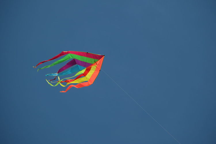 Copy Space Low Angle View Multi Colored Blue Green Color Day No People Vibrant Color Fly Flying High Flying In The Sky Kite Kitesurfing Kite Flying