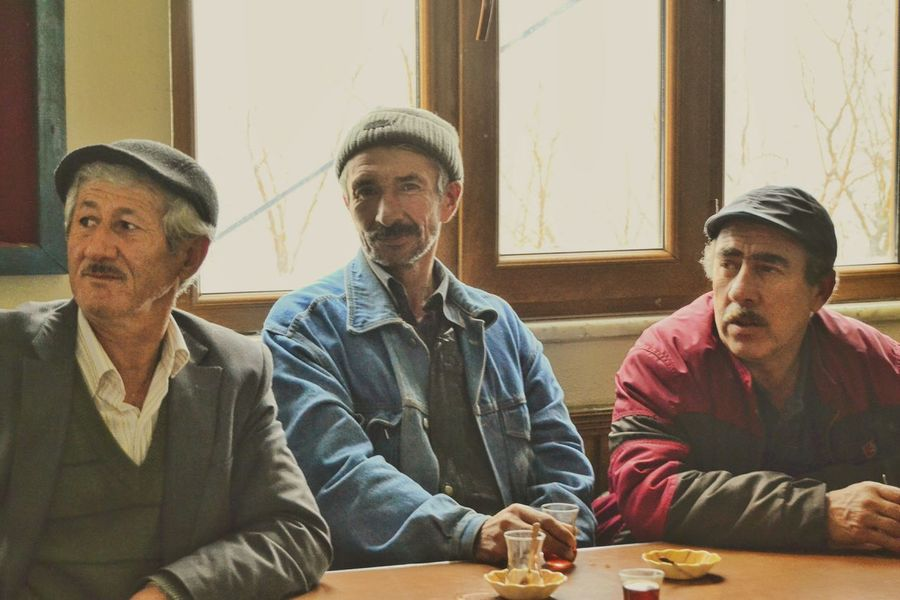 Window Sitting Adults Only Young Adult Indoors  Casual Clothing Togetherness Adult People Friendship Only Men Table Leisure Activity Men Flat Cap Happiness Home Interior Day Eyeglasses  Portrait