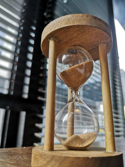 Low angle view of hourglass on table