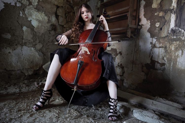 Cello One Person Playing Musician Music Musical Instrument Real People Young Adult Full Length Day Outdoors Adult People Adults Only Viyolonsel Viyola Cellist Music Music Is My Life Musical Instruments Blackandwhite Hair Hairstyle Photography EyeEm Best Shots