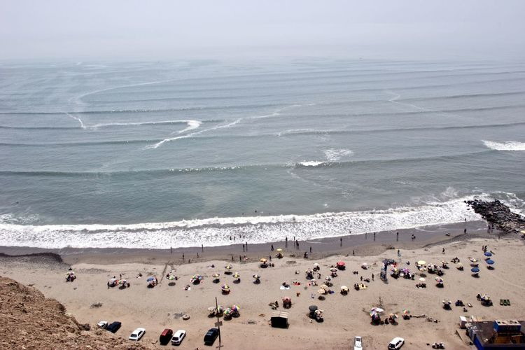 Miraflores coastline From Above  Looking Down Miraflores Aquatic Sport Beach Beauty In Nature Crowd Day Daylight Group Of People High Angle View Holiday Horizon Over Water Land Large Group Of People Leisure Motion Nature Ocean Outdoors Real People Sand Scenics - Nature Sea Surfing Water Wave
