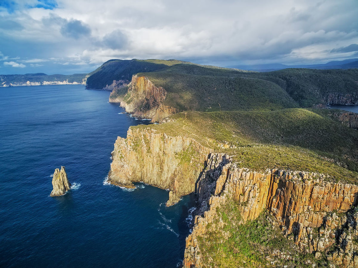 Rugged cliffs of Cape Hauy on bright sunny day aerial view. Tasman National Park, Tasmania, Australia Aerial Shot Australia Australian Landscape Cliffs Coastline Drone  Landscape_Collection Aerial Aerial View Beauty In Nature Beauty In Nature Cape Hauy Cloud - Sky Day Drone Photography Dronephotography Landscape Landscape_photography Mountain Nature No People Outdoors Rock - Object Scenics Sky Tasmania Tasmania Australia TasmaniaAustralia Tasmanian Landscape Tranquil Scene Tranquility Water