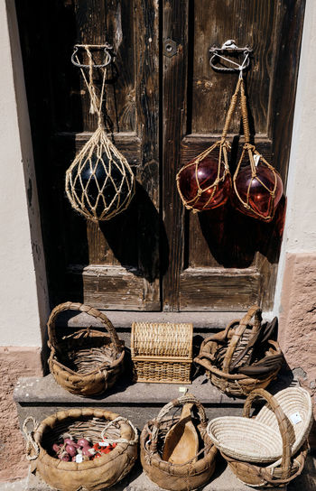 Clothes hanging in basket on wall