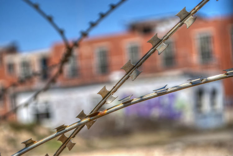 Keep Out Razor Wire Barbed Wire Protection Security Chainlink Fence Sky Architecture Close-up Building Exterior