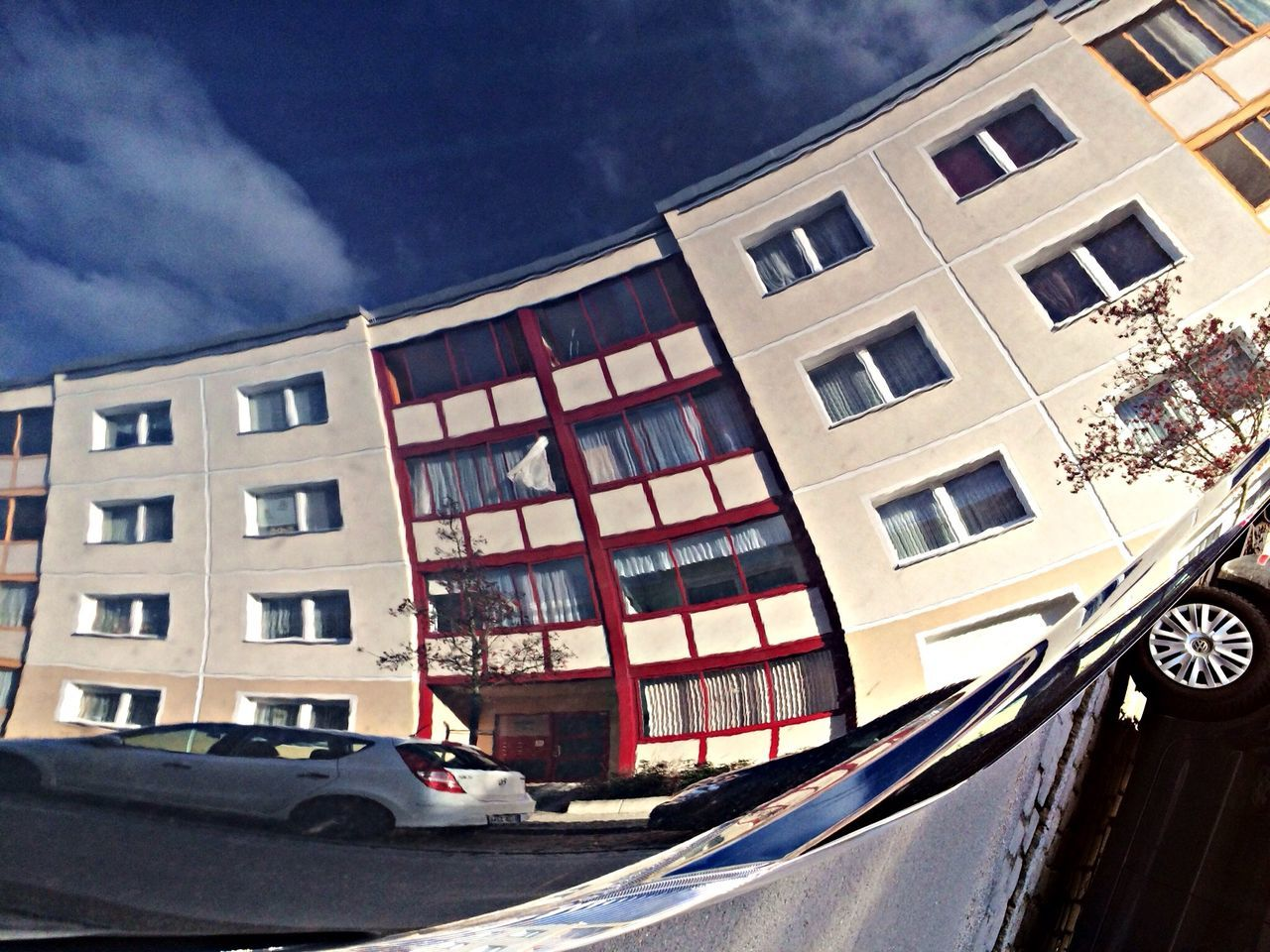 architecture, building exterior, built structure, window, car, outdoors, city, sky, day, no people