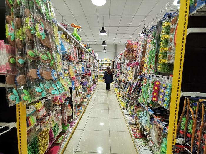 Full length of woman walking in illuminated store