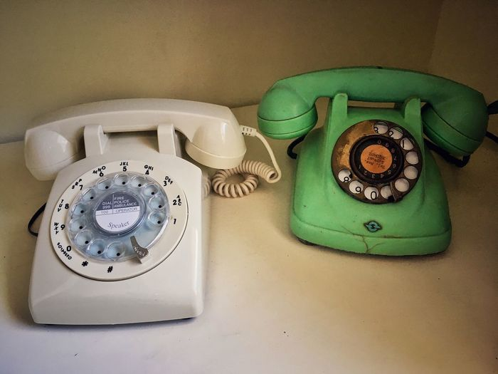 Close-Up Of Old Rotary Phones On Table
