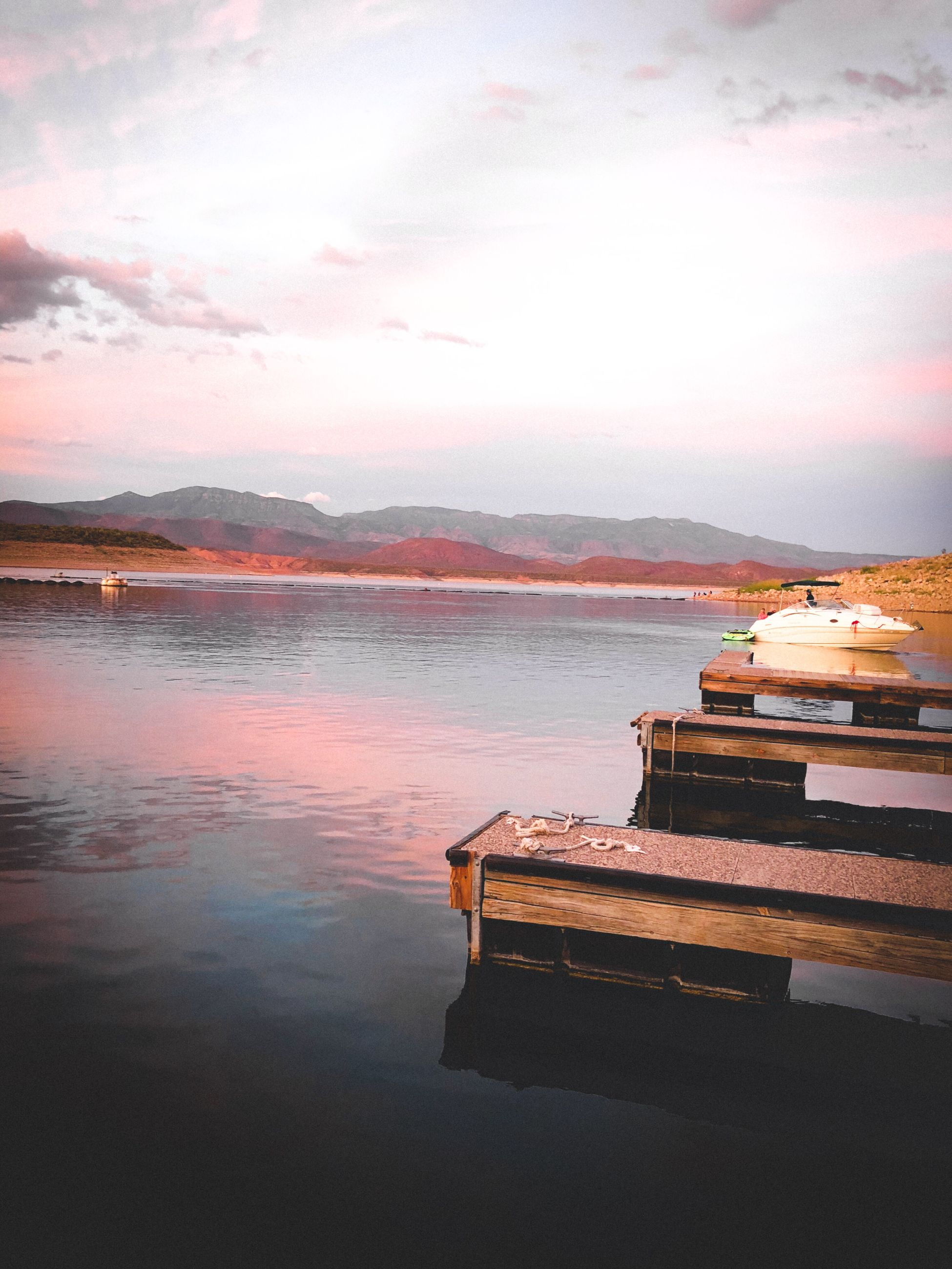 water, sky, cloud - sky, nautical vessel, tranquility, sunset, nature, tranquil scene, beauty in nature, reflection, transportation, scenics - nature, lake, no people, mode of transportation, mountain, outdoors, moored, passenger craft