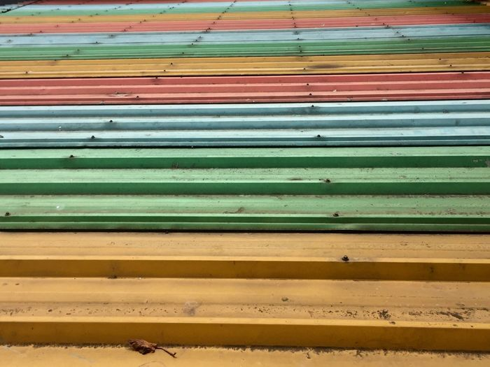 Colorful Roof No People Pattern Full Frame Day Backgrounds Wood - Material Multi Colored Wall - Building Feature Bench Yellow Metal Architecture Green Color Close-up Repetition Abundance Iron