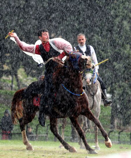 Javelin game Rainy Days Rain Horse Riding Running Competition Grass Field Full Length Horseback Riding Outdoors People Speed Adult Sports Race Mid Adult Motion Rural Scene Only Men Two People Adults Only Domestic Animals