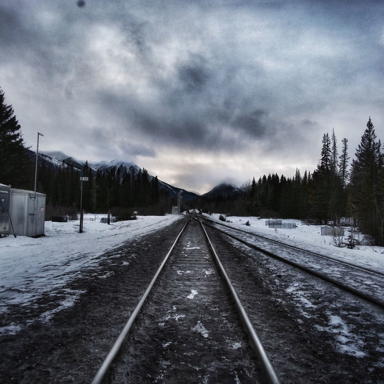 cold temperature, snow, weather, winter, transportation, railroad track, rail transportation, the way forward, nature, sky, no people, cloud - sky, outdoors, tranquil scene, scenics, landscape, day, beauty in nature, tree