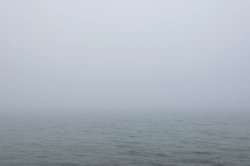 Abstract Backgrounds Copy Space Environment Fog Gray Horizon Over Water Mist No People Overcast Poor Visibility Sea Sky Tranquility Water