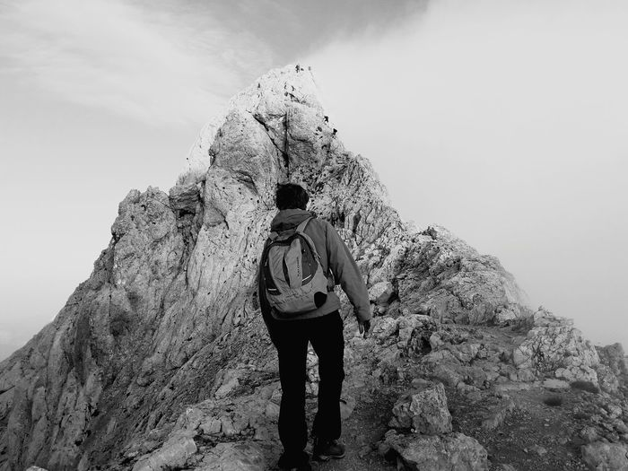 In mountains. Adventure Outdoors Nature Sky Backpack Black & White Longway Hiking