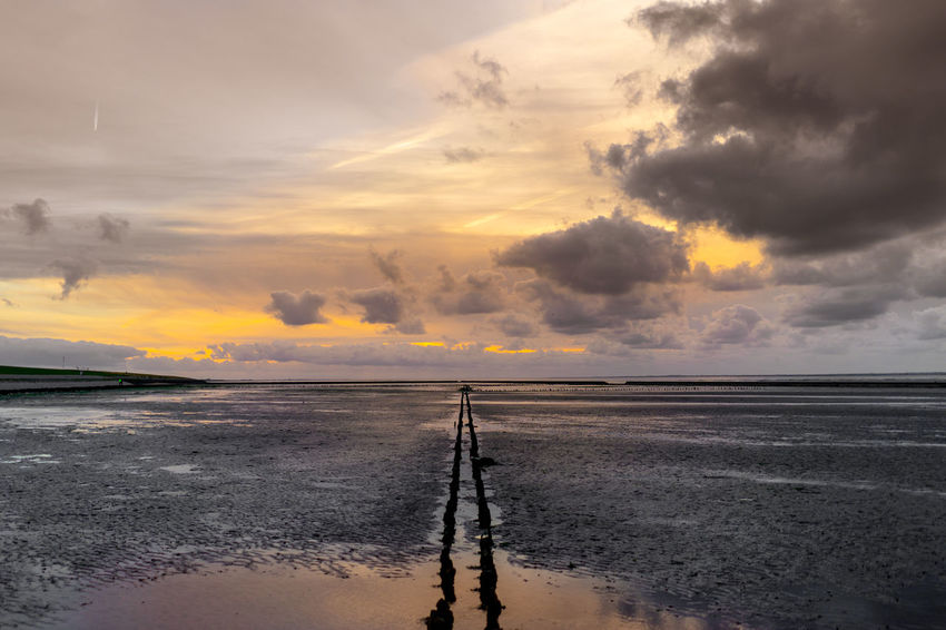 Sky Cloud - Sky Water Sunset Scenics - Nature Reflection Beauty In Nature Tranquil Scene Tranquility Sea Horizon Over Water Nature Horizon Beach Land Idyllic No People Non-urban Scene Surface Level
