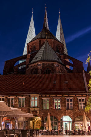 St. Marienkirche 13st Century Architecture Blue Building Exterior Built Structure Chairs And Tables Church Church Towers City Downtown District Illuminated Low Angle View Lübeck City Lübeck, Germany Mitnight No People Outdoors Parasols Place Of Worship Religion Schleswig-Holstein Sky Spirituality Travel Destinations
