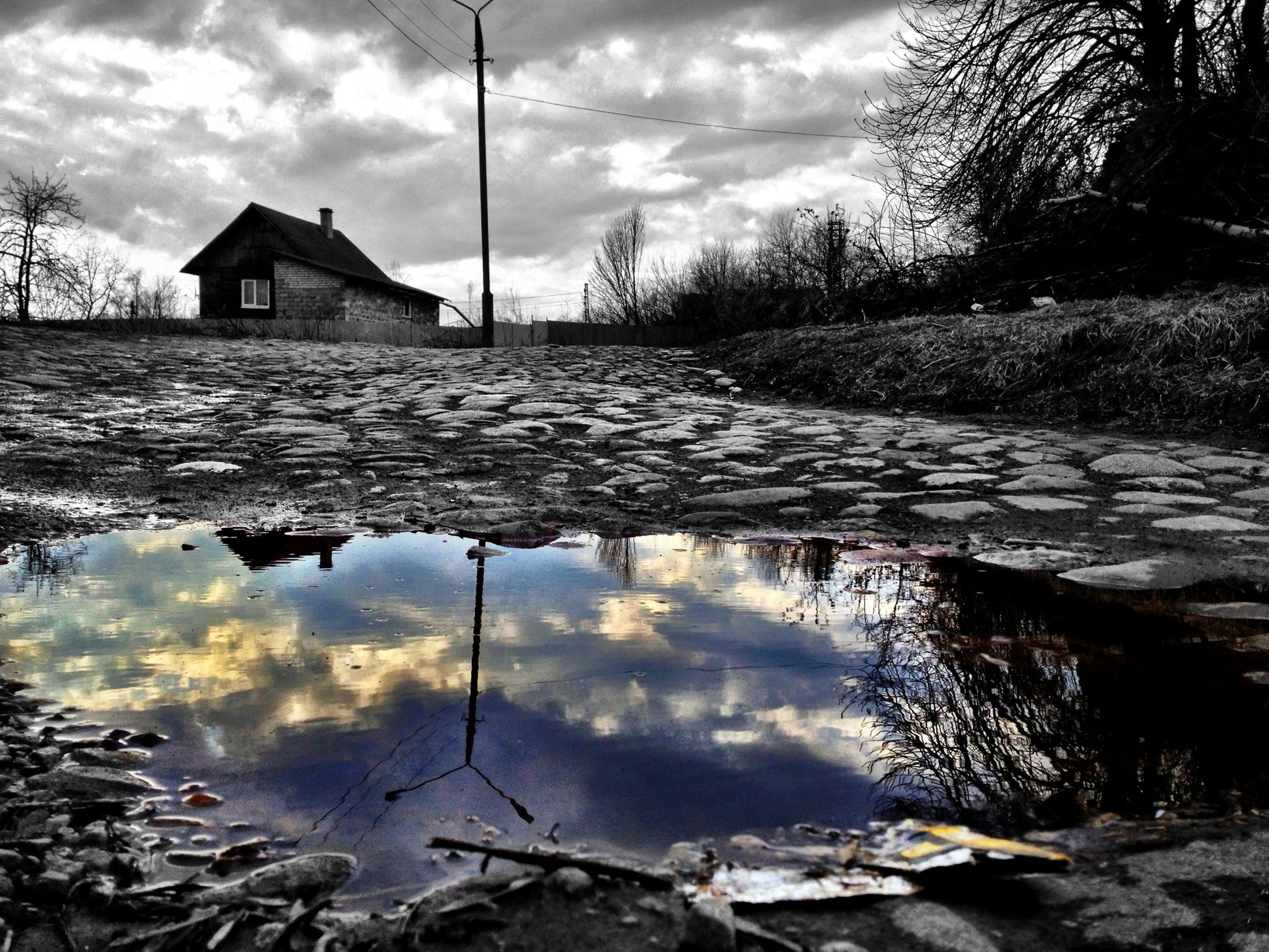 water, reflection, sky, cloud - sky, lake, built structure, building exterior, cloud, architecture, tranquility, tranquil scene, tree, cloudy, nature, scenics, river, beauty in nature, house, day, puddle