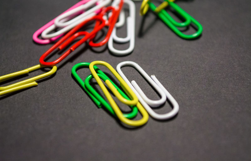 Paper Clip Clip Office Supply Still Life Multi Colored Green Color Table Office Close-up Indoors  Metal No People Group Of Objects Man Made Large Group Of Objects Man Made Object Equipment Gray Choice Group