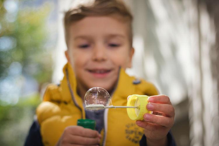 Portrait of smiling boy holding drink