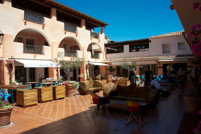 Porto Cervo Architecture Blue Sky Building Exterior Architecture Built Structure Chair City Clear Sky Day Light And Shadow Outdoors People Porto Cervo, Sardinia Real People Summertime Travel Destinations
