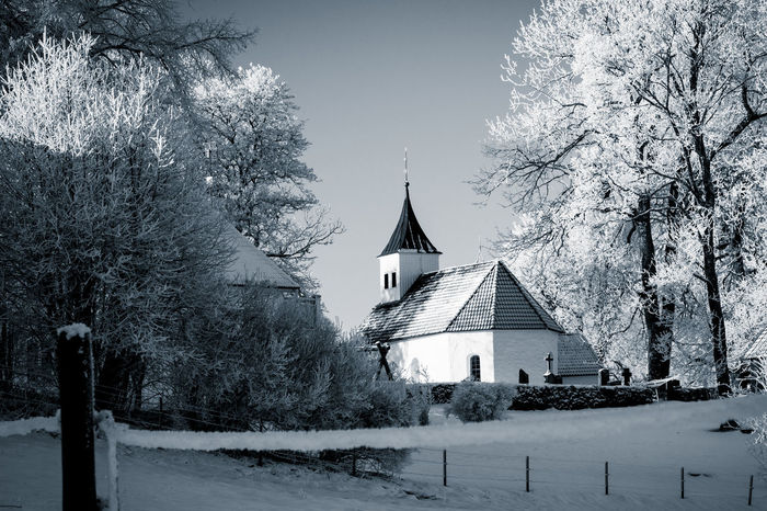 Church EyeEm Best Shots - Black + White Wintertime Architecture Bare Tree Beauty In Nature Black And White Branch Building Exterior Built Structure Clear Sky Cold Temperature Day Monochrome Nature No People Outdoors Place Of Worship Religion Sky Snow Spirituality Tree Winter Winter Wonderland Shades Of Winter