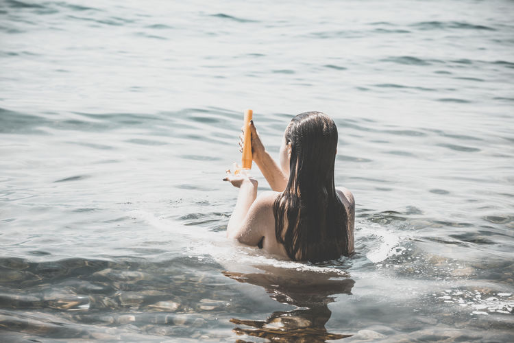 Lepidoptera Camping Garda Girl Hair Hair Washed Holiday Italy Lago Di Garda Lake Nature Ocean One Person Open Hand Outdoors Sea Shampoo Sitting Vacations Wash Washing Water Wave Woman Woman Portrait Young Adult