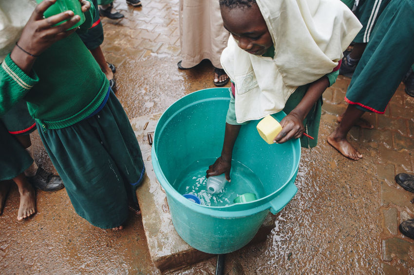 Africa African Cheerful Children Clean Clean Water Close-up Cups Drinking Drinking Water Filter Group Happiness Health Kids Muslim PLASTIC CONTAINER Safe School Social Business Students Thirsty  Uniform Water Water Filter