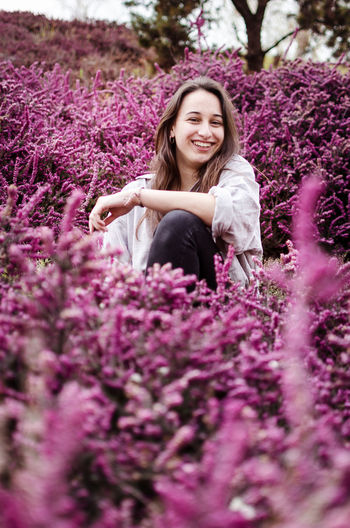 Purple Purple Flowers Springtime Spring Pink Flower Pink Flowers Pink Color Purple Color Smiling Happiness Flower Flowering Plant Plant One Person Young Adult Young Women Women Beauty In Nature Adult Portrait Nature Growth Looking At Camera Beauty Beautiful Woman Freshness Front View Hair Hairstyle Outdoors Lavender