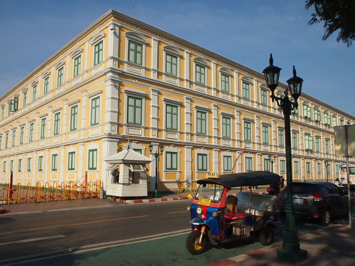 Building of Ministry of Defence (Thailand) in Bangkok Architecture Bangkok Outdoor Government Building Storeys Yellow Structure Vintage Blue Sky City TukTuk Thailand Outdoor Street Day Street Scene
