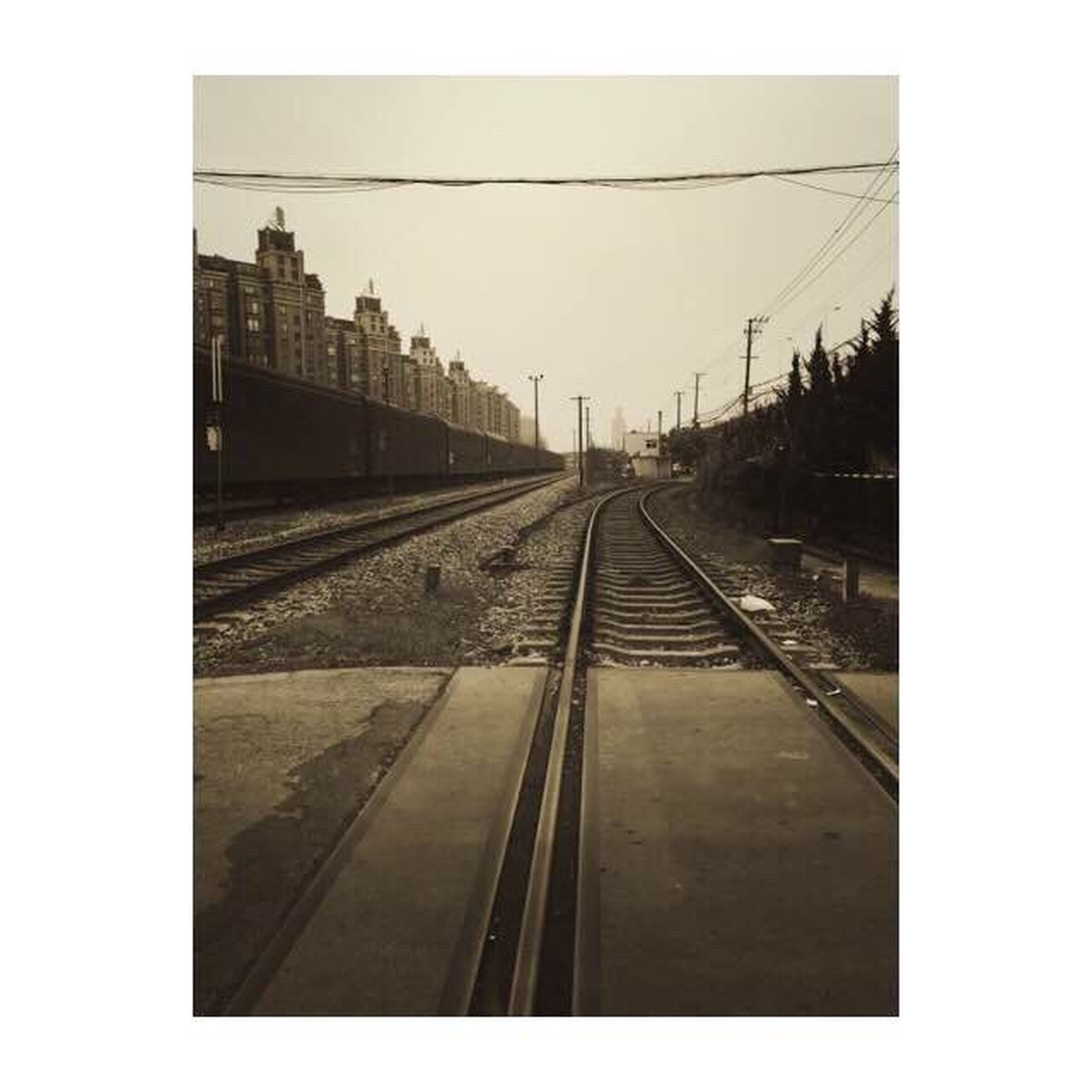 transfer print, railroad track, rail transportation, diminishing perspective, the way forward, auto post production filter, transportation, built structure, architecture, vanishing point, clear sky, public transportation, sky, railway track, long, day, building exterior, connection, railroad station, no people