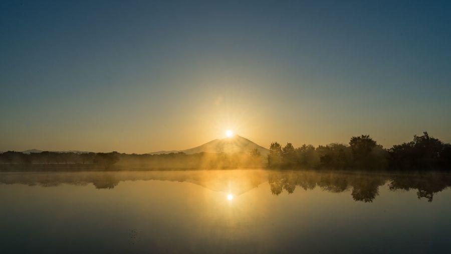 Diamond Tsukuba. Water Sky Reflection Beauty In Nature Lake Tranquility Scenics - Nature Tranquil Scene Sunset Sun Tree Idyllic No People Nature Waterfront Copy Space Plant Sunlight Non-urban Scene Outdoors