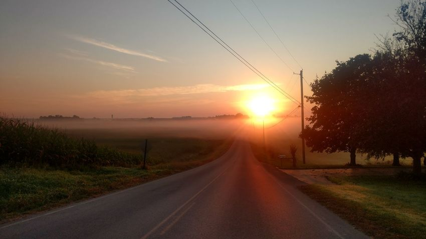 Morning sunrise through the fog on an old country road. Sunset Sun Sunlight Sunbeam Road Sky Morning Cloud - Sky Scenics Agriculture The Way Forward Field Summer No People Rural Scene Beauty In Nature Outdoors Landscape Nature Dawn
