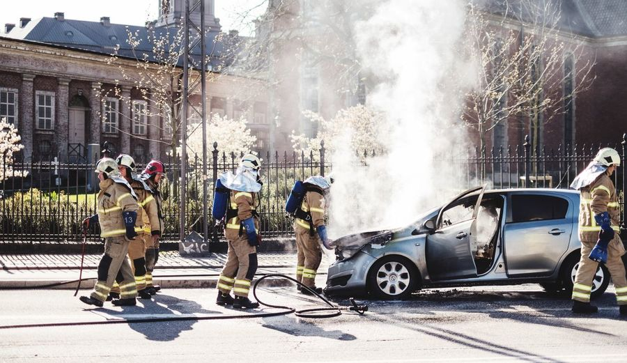 Home from work Car Crash Smoke City Street Building Exterior Real People Transportation Sunlight Architecture Group Of People Built Structure Incidental People Mode Of Transportation Men Day Car Motor Vehicle Land Vehicle Nature People Sunny Occupation Adventures In The City