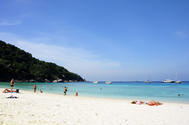 SIMILAN ISLANDS, PHANG NGA, THAILAND - DEC 31, 2009 Beaches of Similan Islands It is a famous tourist attraction in Thailand. Located in Phang Nga, Thailand. Coastline Thailand Tourist Backgrounds Beach Beauty In Nature Daylight Destinations Island Landscape Lifestyles Mountain Nature Outdoors People Sand Scenics Sea Sky Sunbathe Swimmer Tourism Travel Destinations Vacations Water