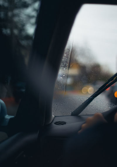 Close-up of wet car window in rainy season