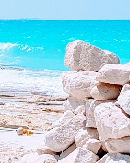 North coast, Alexandria, Egypt Water Sea Beach Beauty Wave Summer Relaxation Sky Horizon Over Water Stack Rock Coast Calm Sandy Beach Rock Formation Sand