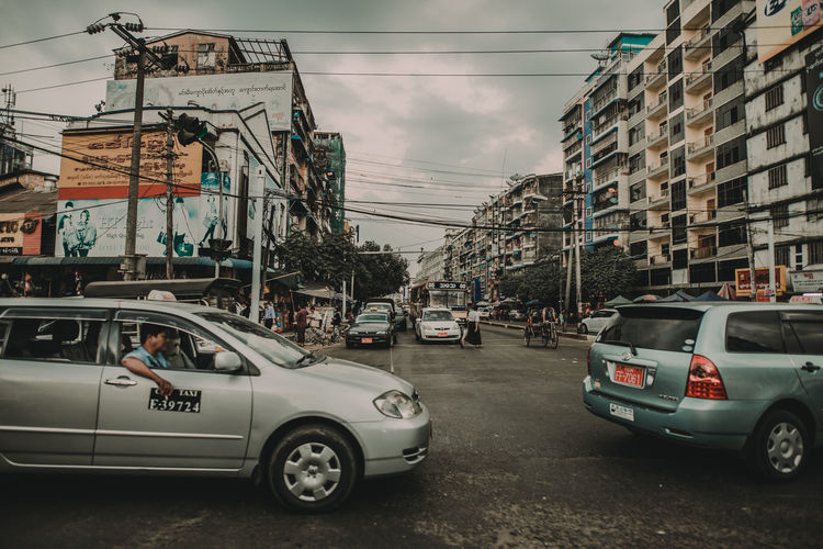 street myanmar Mode Of Transportation Transportation Land Vehicle Motor Vehicle Car Outdoors Streetphotography Photojournalism City Architecture Building Exterior Sky Built Structure Street Nature Cloud - Sky Day Road Cable Incidental People Building Power Supply