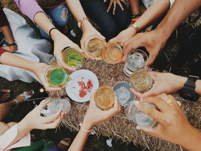 High angle view of people drinking glasses