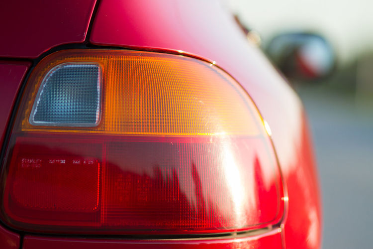 Detail of rear light of red sports car, Honda Car Close-up Detail Focus On Foreground Honda Land Vehicle Mode Of Transport Part Of Rear Light Red Reflection Sports Car Transportation Travel