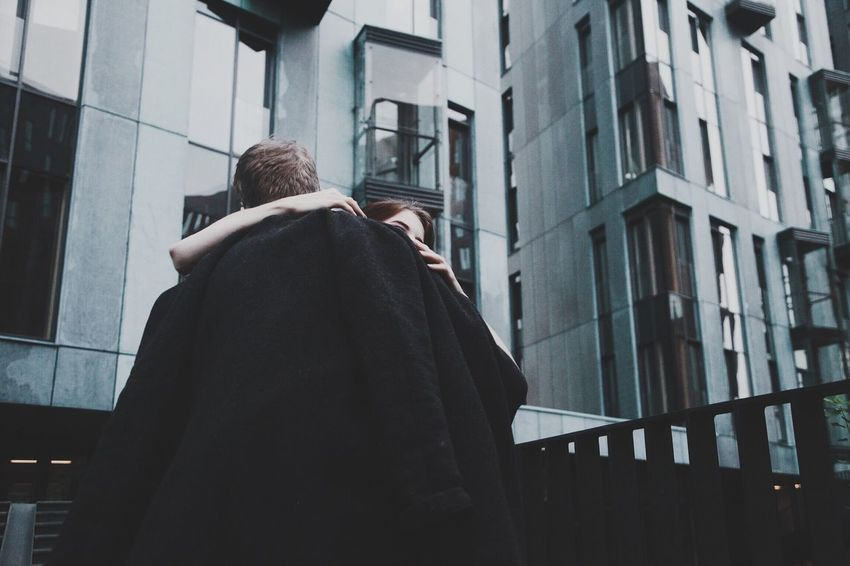 Architecture Building Exterior City Person City Life Focus On Foreground Outdoors Casual Clothing Love Friends Hug Vscocam VSCO People Built Structure Rear View Low Angle View Building Office Building Traveling Home For The Holidays
