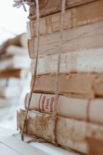 Close-up of paper stack on wood