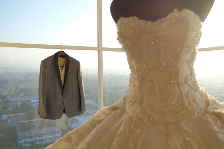 Man suits and wedding dresses are very romantic exposed to the warm morning sun.